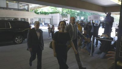 Images of Huawei executive arriving at court ahead of ruling