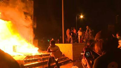 Police precinct in flames in US protest over death of black man