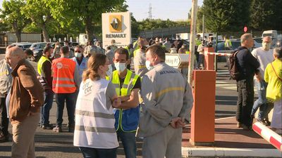 Renault employees gather at plant after news of jobs cuts