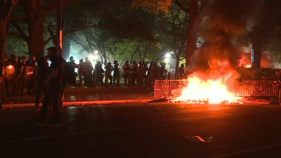 US protesters light fires near White House