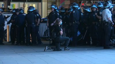 Woman takes the knee in front of cops in Brooklyn