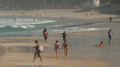 Cariocas stroll down Rio beach as city eases virus stay-at-home order