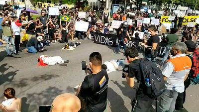 Brazilians recreate George Floyd death during protest against Bolsonaro