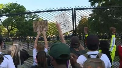 Protesters rally outside the White House as curfew begins