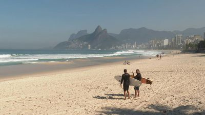 Surfers hit Ipanema beach as Rio eases virus restrictions