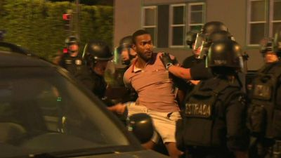 Police make arrests during a protest in Los Angeles