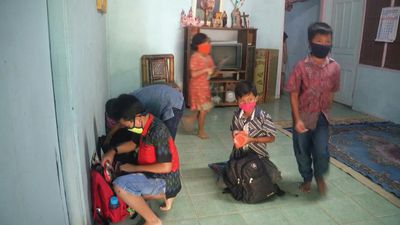 Indonesian teachers take on perilous journey as pupils lack acccess to online learning