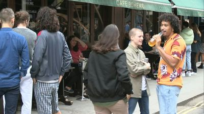 Londoners take to Soho's streets as pubs and bars reopen