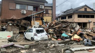 Destruction and debris on streets after deadly floods in Japan