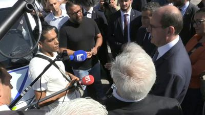 French PM visits scene of Dijon violence, meets local resident