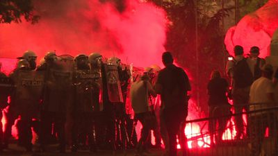 Protesters throw firecrackers at police in Belgrade protest