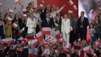 Poland's populist president narrowly wins re-election