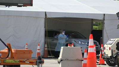 Cars line up at COVID-19 test site in Miami as Florida cases surge