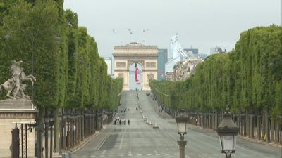Bastille Day: the Champs-Elysées empty, downsized military parade confined to Place de la Concorde