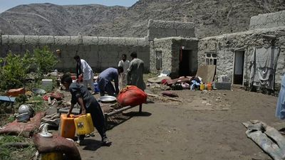 Residents clean up debris after floods ravage Afghan village