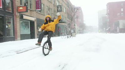 Mainers brave snow storm on unicycles, skis