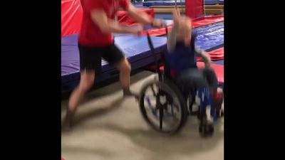 Boy in wheelchair shows off trampoline moves
