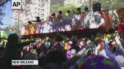 Revelers celebrate Mardi Gras in New Orleans