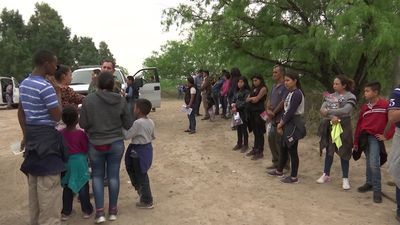 Migrant parents, children enter overtaxed system
