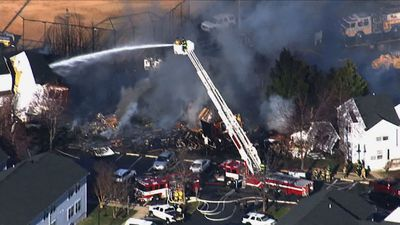 Two dead, 8 firefighters hurt in Maryland blaze