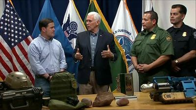 At border, VP Pence calls for end to 'loopholes'