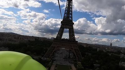 Thill-seekers take zipline ride off Eiffel Tower