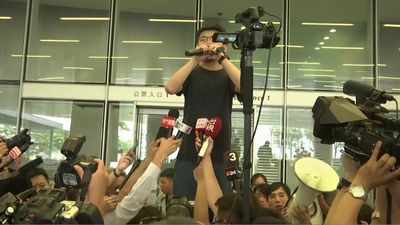 Hong Kong dissident joins protest after prison release