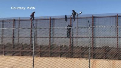 Video shows people climbing fence at border