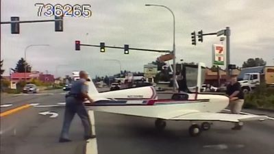 Small plane lands on road as police dashcam rolls