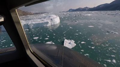Scientists fly over Greenland to track melting ice