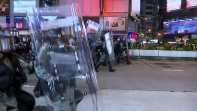 Riot police confront protesters in Hong Kong