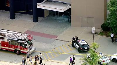 SUV crashes, rolls through suburban Ill. mall
