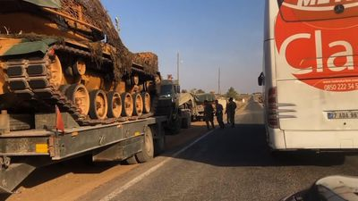 Turkish military convoy crosses into Syria