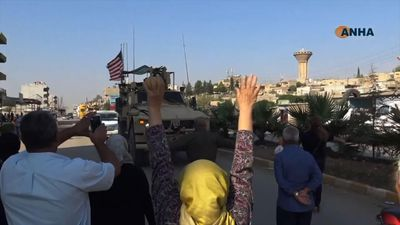 Angry Syrian Kurds pelt US convoy with potatoes