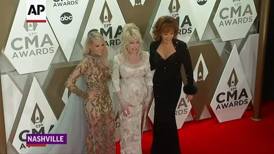 Country music stars hit CMA red carpet