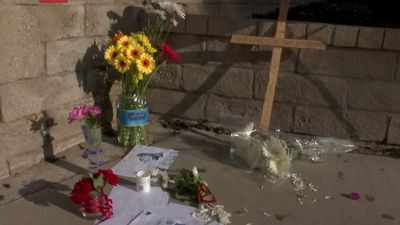 Makeshift memorial grows near school shooting