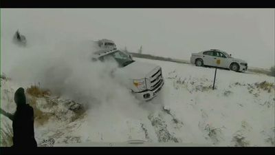 Dramatic video, truck crashes offroad near trooper