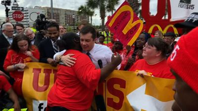Protesters hound Buttigieg at minimum wage march