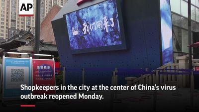 Shops open in Wuhan as virus outbreak wanes