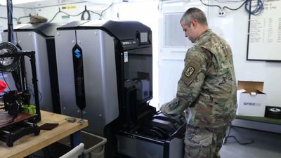 Troops use 3D printers to make virus face shields