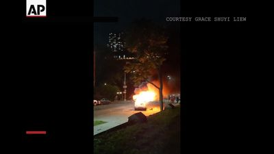 Police van burns in Brooklyn protest
