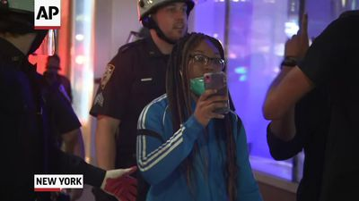 NYPD confronts media as curfew takes effect