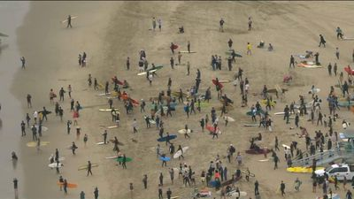 California surfers joing 'paddle out' protest