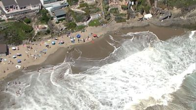 Calif. beachgoers seek surf, sun before closures