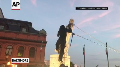 Columbus statue toppled by protesters in Baltimore