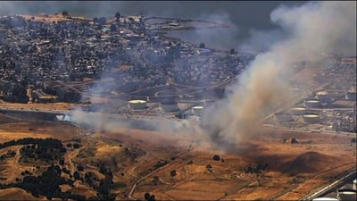 Crews fight Northern Calif. brush fire by highway