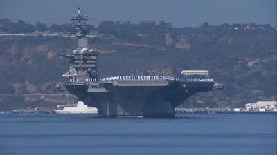 Aircraft carrier returns home after virus outbreak