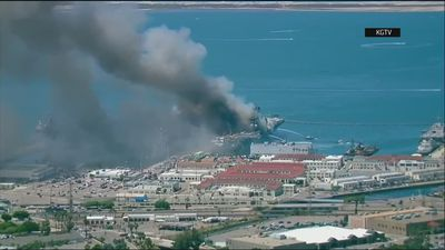 Aerials show ship ablaze at Naval Base San Diego