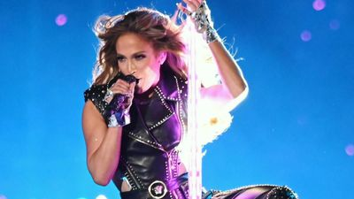 Taking the plunge: JLO's fully-clothed dive!