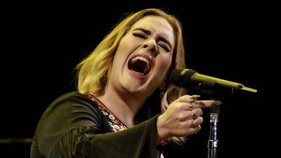 Adele is 'pouring her heart and soul' into her new record